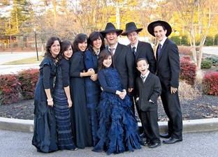 From left: Chani, Sara Leah, Malki, Penina, Efy, Eli, and Morechai; Front: Rus Yaffa and Shaul B.
